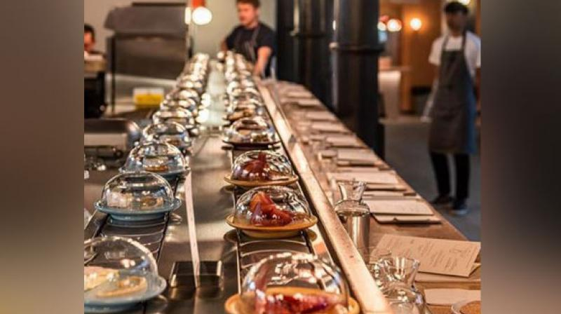 A new restaurant in London is making sure that its customers get to hog on their favourite type of cheese and that too on a conveyer belt. (Photo: ANI)