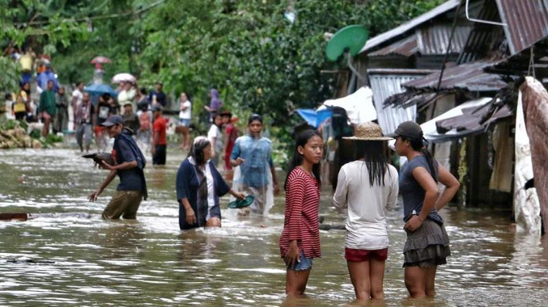 'There are a total of 26 people dead from landslides in four towns of Biliran. We have recovered the bodies,' Sofronio Dacillo, Biliran provincial disaster risk reduction and management officer, said. (Photo: AFP)