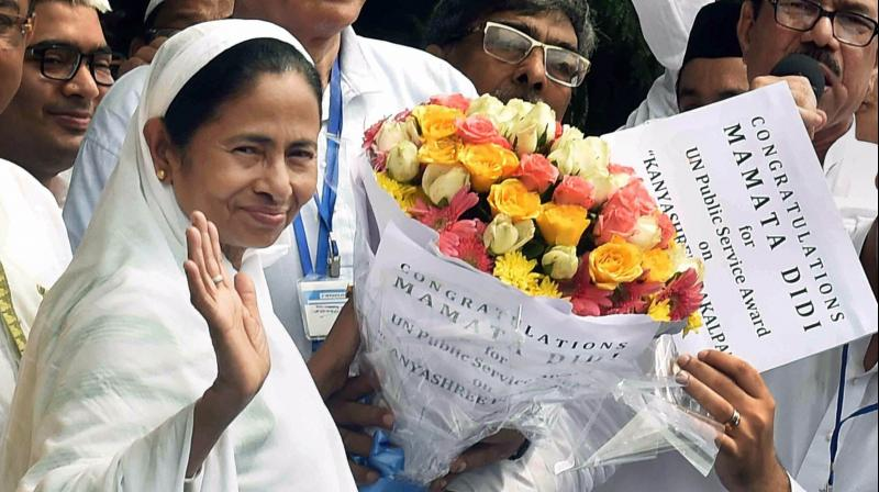 """Chief minister Mamata Banerjee being congratulated after getting UN Public Service Award on """"Kanyasree"""" project at Red Road in Kolkata on Monday. (Photo: PTI)"""