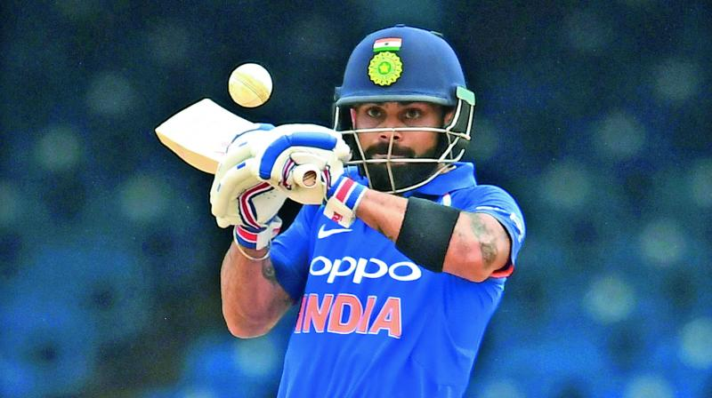 India's captain Virat Kohli plays a shot during the second ODI cricket match against West Indies at Queen's Park Oval in Port of Spain.