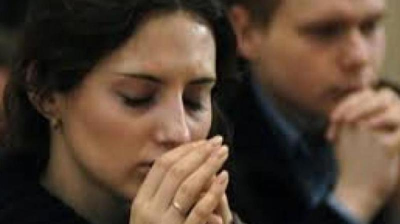Praying (Photo: AP)
