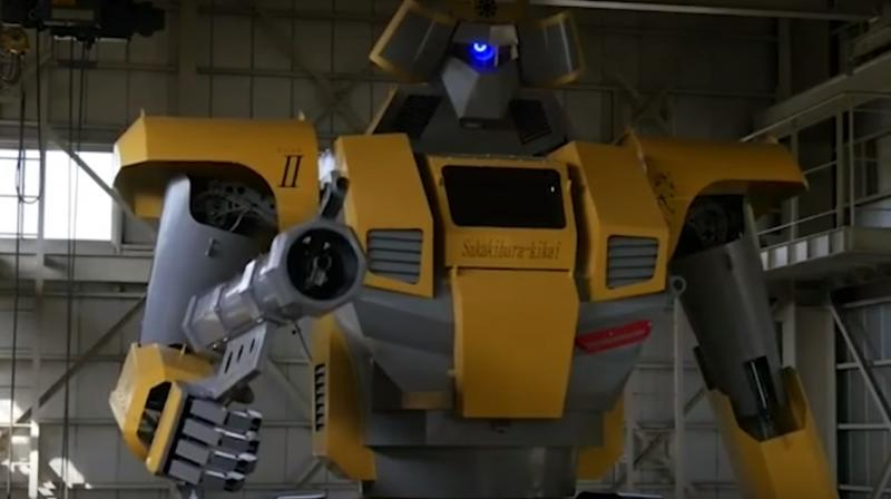 It contains a cockpit with monitors and levers for the pilot to control the robot's arms and legs.