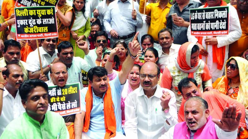 Delhi BJP chief Manoj Tiwari along with party workers raised slogans demanding water-power supply in New Delhi on Wednesday. (Photo: PTI)