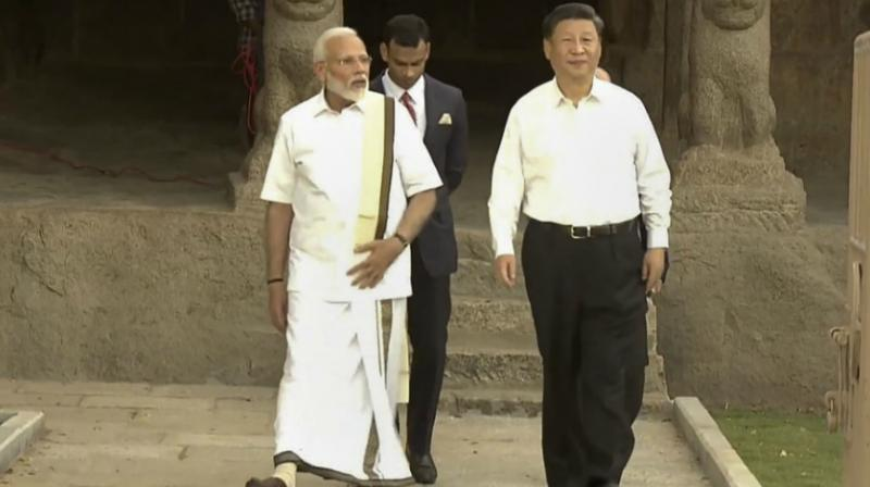 Image result for PM Modi Dons Tamil Nadu's Traditional 'Veshti' as He Welcomes Xi, Wins Praise from Regional Parties