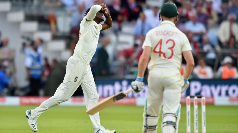 England fast bowler Jofra marked his Test debut with a wicket as Australia suffered a top-order collapse at Lord's on Friday. (Photo:AFP)
