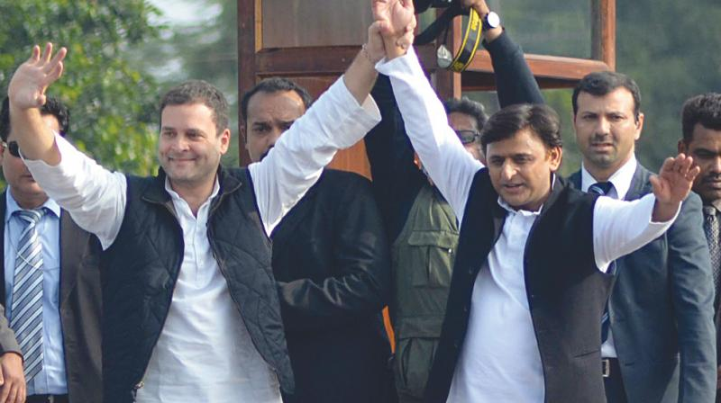 Uttar Pradesh chief minister Akhilesh Yadav with Congress vice-president Rahul Gandhi in Lucknow. (Photo: AP)