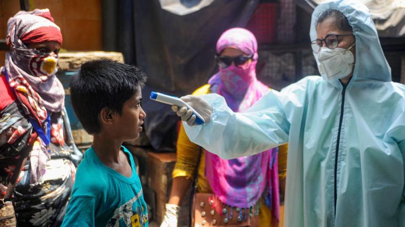 Health staff screen women for influenza-like symptoms of coronavirus infection. (DC Photo: Satish B)