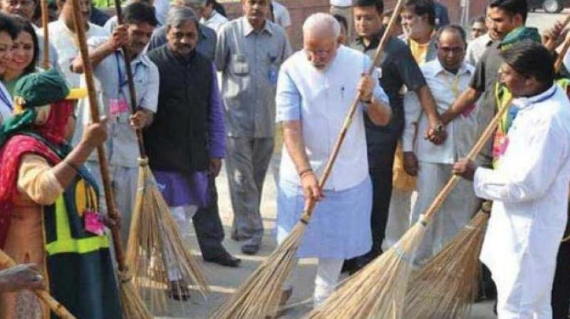 PM Narendra Modi sweeping streets at the launch of the Swachchh Bharat Abhiyan four years ago.