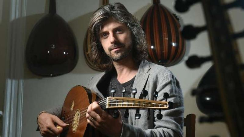 Musician Tristan Driessens is one of the West's few masters of the oud, the oriental lute, and now works with refugees to preserve and develop their musical culture in their new host country. (Photo: AFP)
