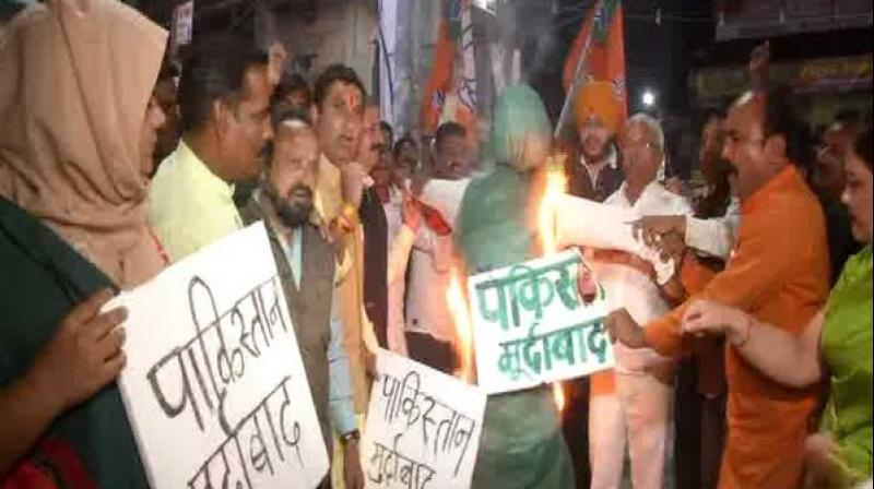 Effigies of Masood Azhar, the chief of Jaish-e-Mohammed, were burnt in Varanasi as a sign of protests against the killing of the security personnel on Thursday. (Photo: ANI)