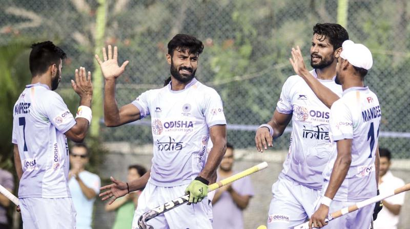 Indian players celebrate their 4-0 win over New Zealand in the last game of the three-match series in Bengaluru on Sunday.