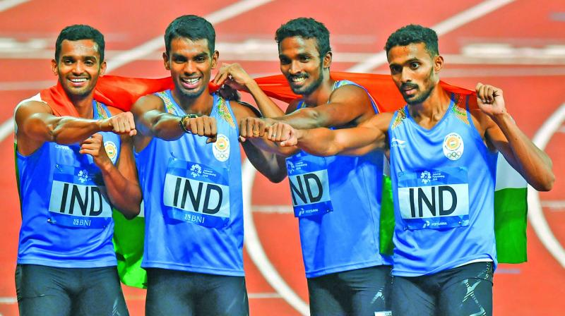 S. Arokia Rajiv (third from left) celebrates his medal with his team-mates. (Photo: AP)