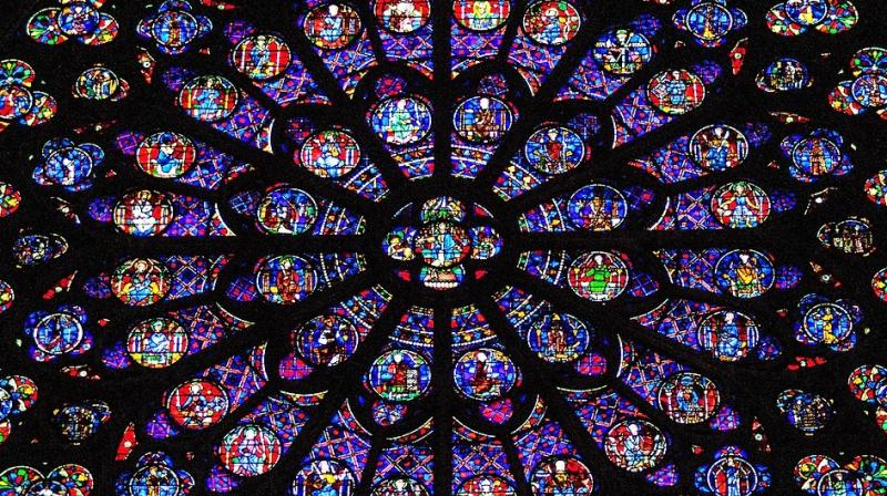 Notre-Dame's famed stained-glass rose windows and most of its many religious relics appeared to have escaped the worst of Monday's inferno, easing fears for the fate of the vast trove of artworks. (Photo: Representational/Pixabay)
