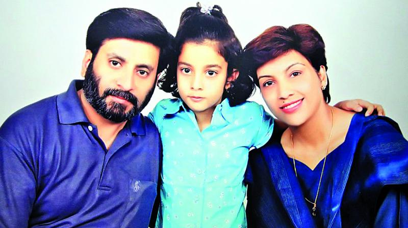 Aarushi with her parents