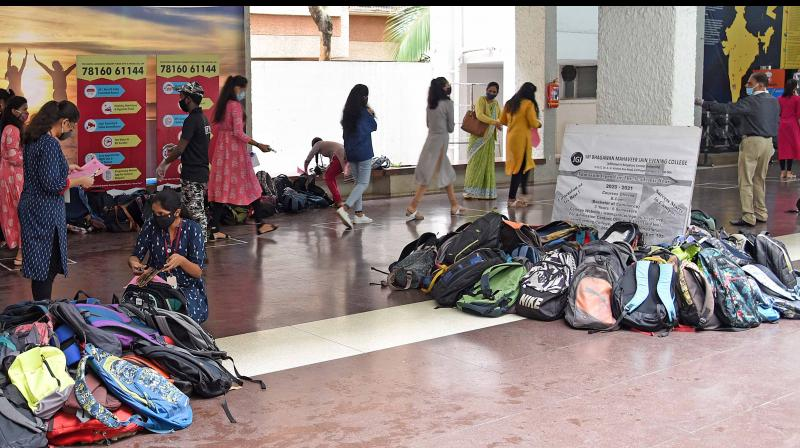 File picture shows students head to exam halls. — B Satish