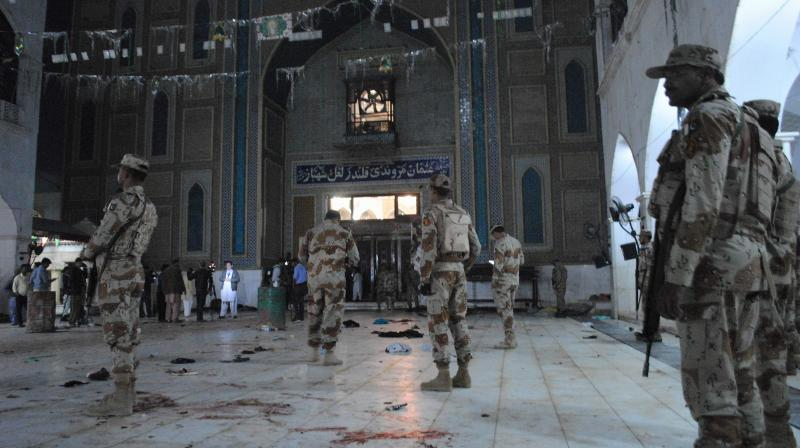 Pakistani para-military soldiers stand alert after a deadly suicide attack at the shrine of famous Sufi Lal Shahbaz Qalandar in Sehwan, Pakistan. (Photo: AP/File)