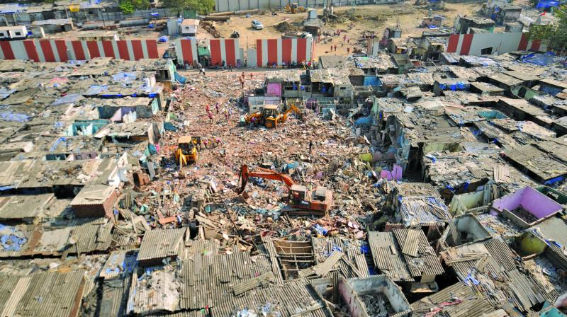 The slums that were demolished at Mahalaxmi on Friday. (Photo: Debasish Dey)
