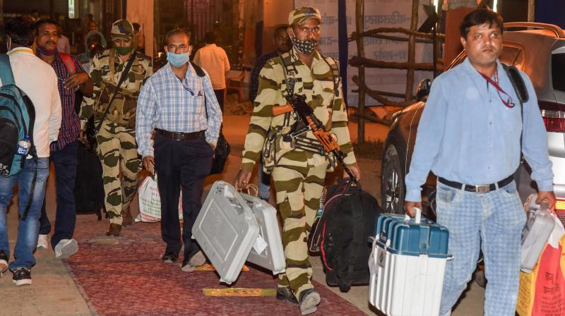 Patna: Security personnel and polling officers carry Electronic Voting Machines (EVMs) to deposit at a strong room after the second phase of Bihar Assembly polls, in Patna, Tuesday, Nov. 3, 2020. (PTI Photo)