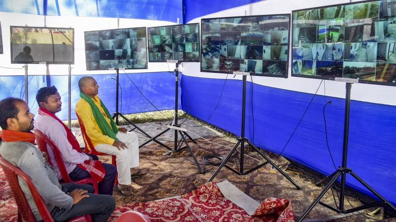 Patna: Grand Alliance supporters monitoring strong room through CCTV footage at AN College ahead of the Bihar Assembly results, in Patna, Sunday, Nov. 8, 2020. (PTI Photo)