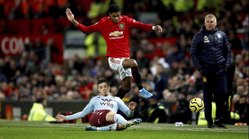 A short corner led to Andreas Pereira floating in a deep cross which Marcus Rashford rose well to head against the post with the ball bouncing in off helpless Villa keeper Tom Heaton in the 42nd minute. (Photo:AP)