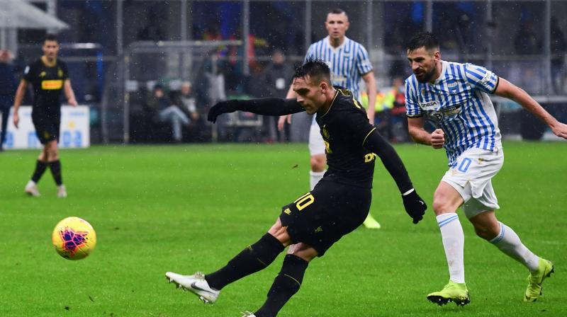 Lautaro Martinez's first-half brace sent Inter Milan top of Serie A on Sunday with a 2-1 win over SPAL after champions Juventus were held at home by Sassuolo. (Photo:AP)