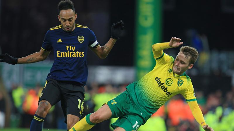 Pierre-Emerick Aubameyang once again rescued Arsenal as his brace earned them a 2-2 draw at Norwich City in Freddie Ljungberg's first game as caretaker manager on Sunday. (Photo:AP)