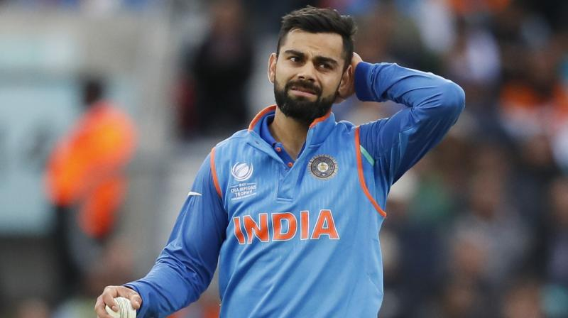 India's captain Virat Kohli scratches his head during the ICC Champions Trophy match between India and Sri Lanka at The Oval cricket ground in London. (Photo: AP)