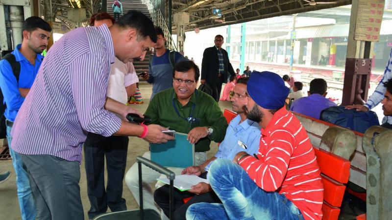 Chief vigilance officer, northern railway, Manish Tiwari interacts with passengers at New Delhi railway Station.