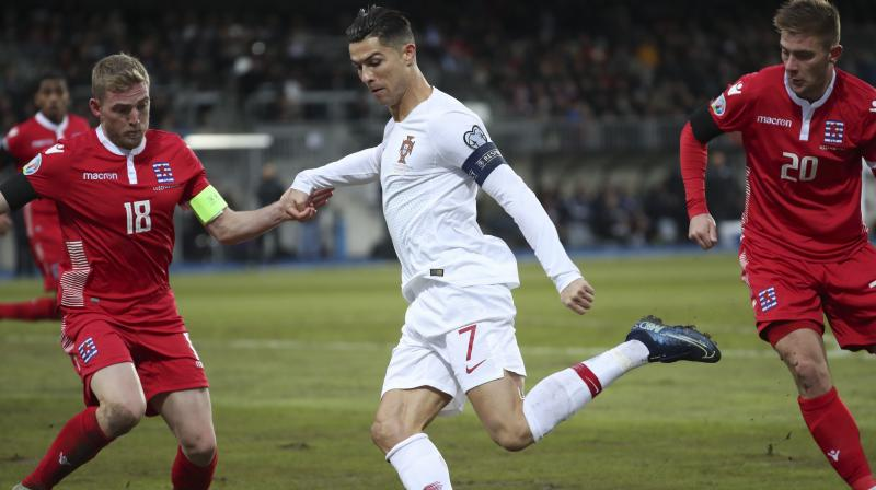 Portugal captain Cristiano Ronaldo scored his 99th international goal as the defending champions edged past Luxembourg 2-0 in difficult conditions away from home on Sunday to qualify for Euro 2020. (Photo:AP/PTI)