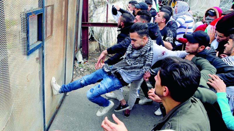 Protesters try to enter the US embassy during a demonstration in Aukar, Lebanon. (Photo: AP)