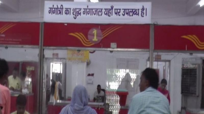 'The post office is not earning anything from this service; it is a no loss and no profit scheme. People are really happy and are coming in good numbers to receive Ganga jal as Shivratri is approaching,' a post office official said. (Photo: ANI)