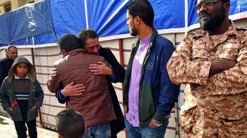 Mourners embrace each other after the explosion in the  eastern city of Benghazi on Wednesday. The death toll following a double car bomb attack in the Libyan city of Benghazi night rose to at least 34, a hospital spokeswoman said. (Photo: AFP)