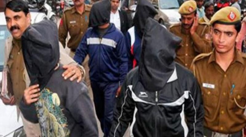 The convicts in the Nirbhaya case being taken to court (Photo: PTI)