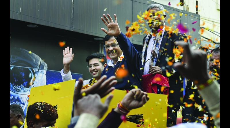 CM Arvind Kejriwal during a roadshow in support of the party candidate Raghav Chaddha in New Delhi on Wednesday. — PTI
