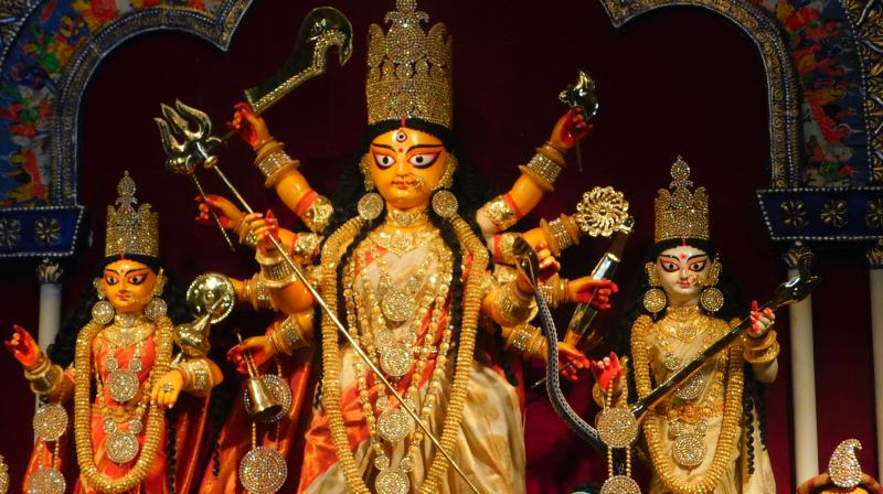 During Durga Puja, many devotees offer prayers to the Goddess precisely on the belief that she will protect them and their families in times of need. (Photo: Supratim Chakraborty)
