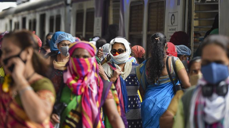 Women passengers deboard a local train after the authorities allowed them to commute during non-peak hours from 11 AM to 3 PM and from 7 PM till the end of the service, at Kurla in Mumbai, Wednesday, Oct. 21, 2020. (PTI )