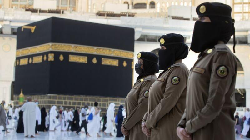 Saudi police women, who are recently deployed to the service, stand alert in front of the Kaaba, the cubic building at the Grand Mosque, during the annual hajj pilgrimage, in Saudi Arabia's holy city of Mecca. (AP)