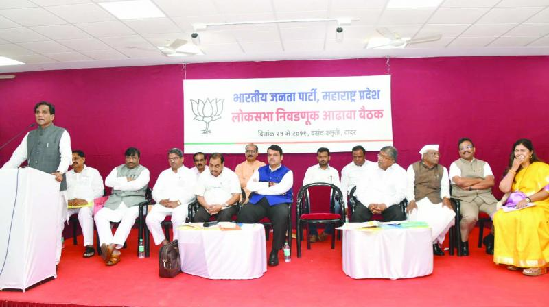 Chief minister Devendra Fadnavis and other BJP  leaders at the meeting held at the party's office in Dadat on Tuesday. 	— Asian Age