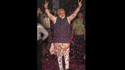 Indian Prime Minister Narendra Modi displays the victory symbol upon arrival at the party headquarters in New Delhi, India, Thursday, May 23, 2019. (AP)