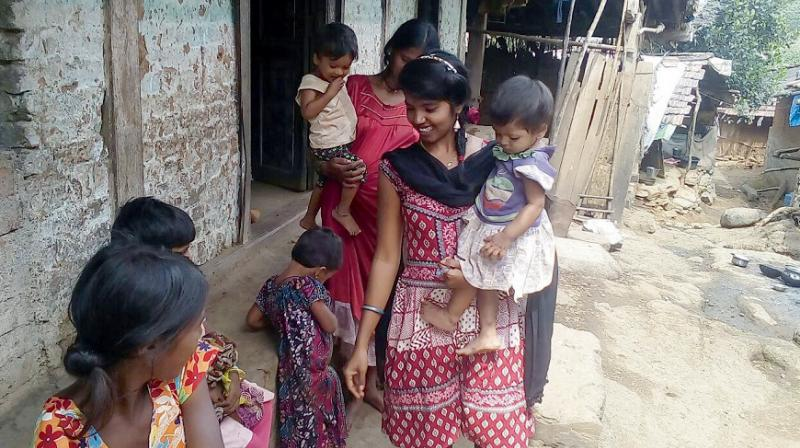 A volunteer helps malnourished children in Thane-Palghar district in Maharashtra.