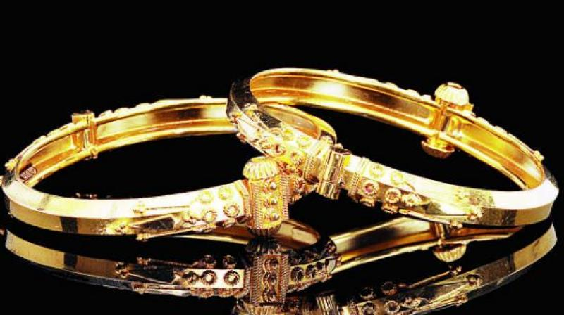 Globally, gold fell 0.30 per cent to USD 1,244.10 an ounce and silver 0.03 per cent to USD 18.29 an ounce in Singapore.