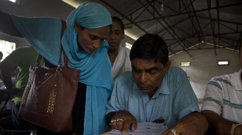 Villagers check their names in the final list of the National Register of Citizens (NRC) at an NRC center in Buraburi village, in Morigaon district, in the northeastern Indian stat of Assam, Saturday, Aug. 31, 2019. (Photo: AP)