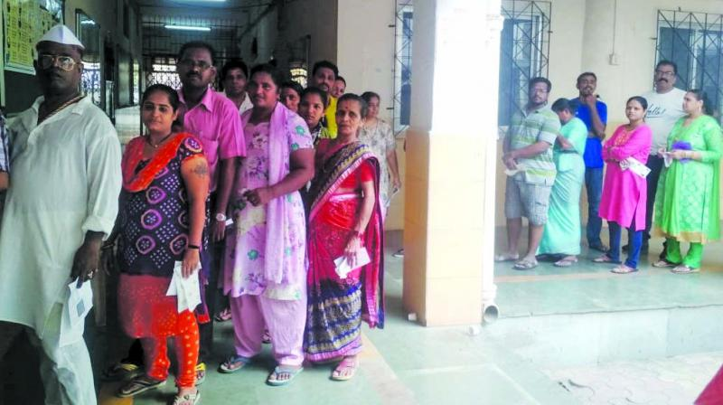 Residents line up to cast their votes in Worli-Koliwada.