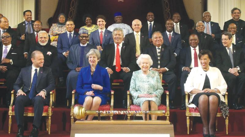 Commonwealth leaders, including Prime Minister Narendra Modi (second from left in second row), pose for a group photograph with Britain's Queen Elizabeth II during the formal opening of the Commonwealth heads of government meeting in Buckingham Palace's ballroom in London. (Photo: AP)