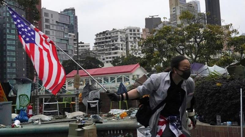 The bill - if it becomes law - will demand greater scrutiny of the city's special status, which among other things prohibit the commercial export of certain munitions to the Communist party-controlled Hong Kong Police Force, would provide sanctions against officials responsible for human rights violations in Hong Kong. (Photo: AP)