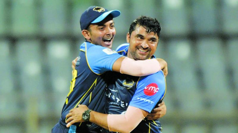 Pravin Tambe,47, of North Mumbai Panthers celebrating a wicket with captain, Prithvi Shaw (19-year-old).