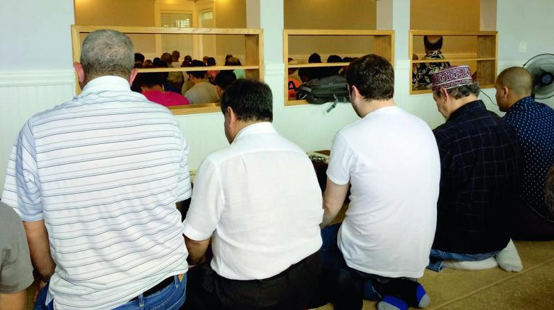 In this photo taken on March 10, men gather for afternoon prayers at the Muslim Association of Hawaii in Honolulu. (Photo: AP)