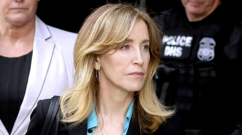 Felicity Huffman arrives at federal court in Boston to face charges in a nationwide college admissions bribery scandal. (Photo: AP)