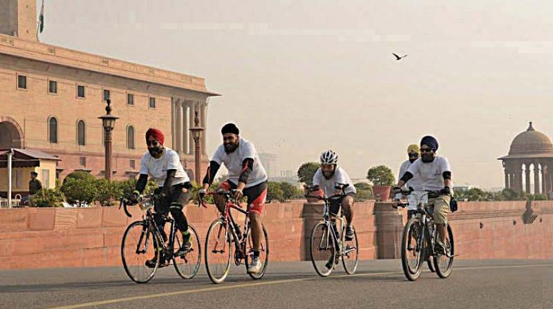 Cyclists take part in a rally to create awareness about pollution in New Delhi on Saturday. (Photo: Asian Age)