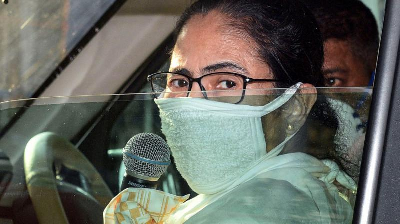 West Bengal CM Mamata Banerjee wearing a mask is seen in her car during the nationwide lockdown. (PTI)